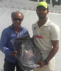 Aniket Seth received man of the match award from Manoj Makar Secretary GCA