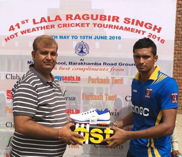 Navdeep Saini received man of the match from Naveen Chopra in Raghubir Cricket